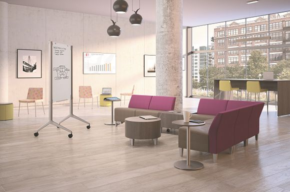 Room scene with Flock modular and casual lounge chair, 4-leg stool, personal table, collaborative cube and cylinder table, mini cylinder seating