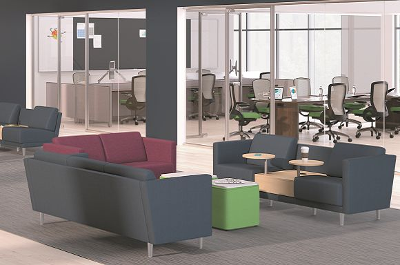 Room scene with furniture - Grove three and two seat lounge, two seat lounge with table, Flock mini cube and cylinder seating, round collaborative table, Motivate markerboard, Ceres task chairs