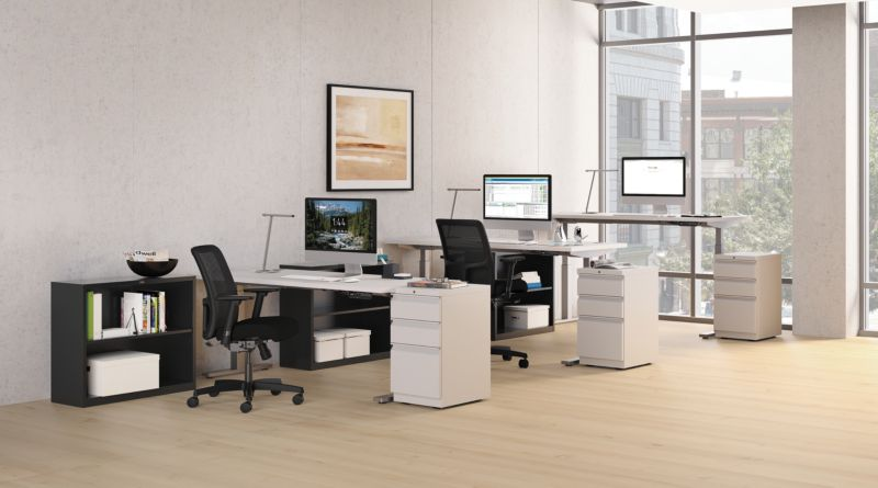 Room scene with furniture - Ignition task chairs, Concinnity height adjustable desks, Brigade mobile pedestal and bookcase