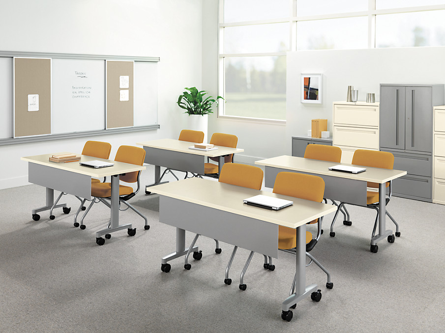 Huddle Tables with Perpetual Chairs in a Training Room