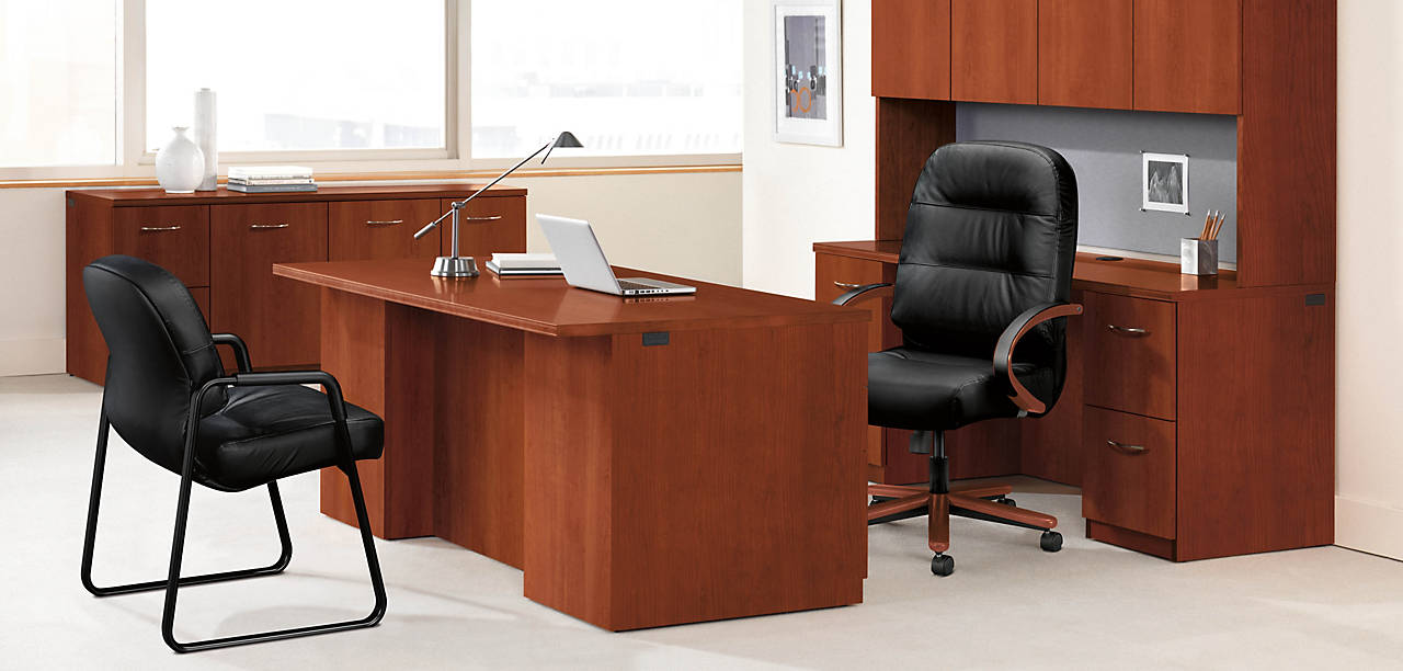 Leather Pillow-Soft Chair behind an Executive Desk