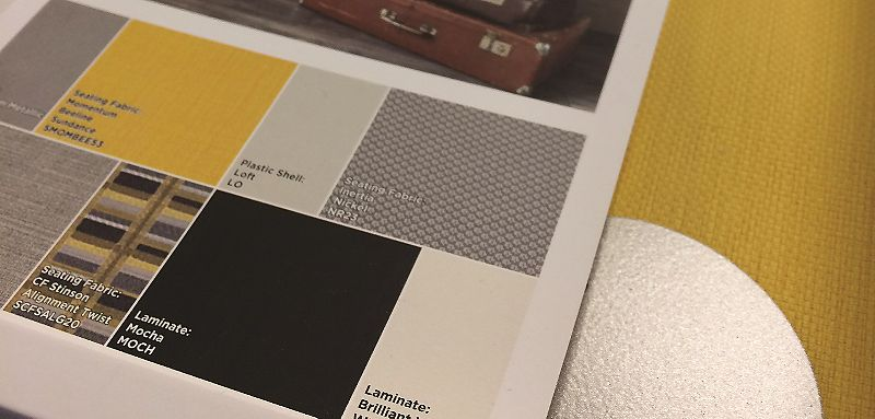 Grey and yellow toned HON Balance color palette that includes Centurion Goldenrod seating fabric in the background
