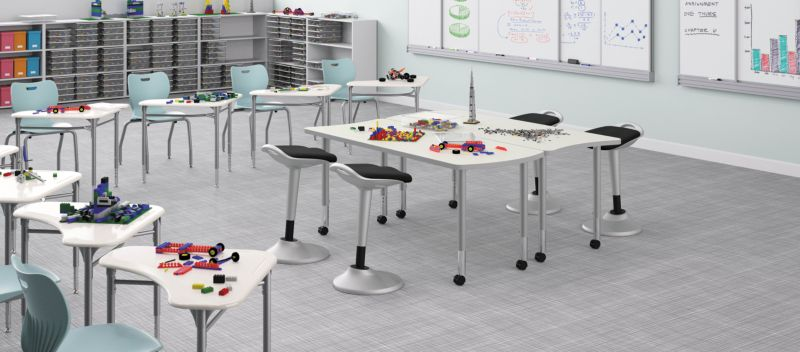 Perch stools with Build Tables in a classroom