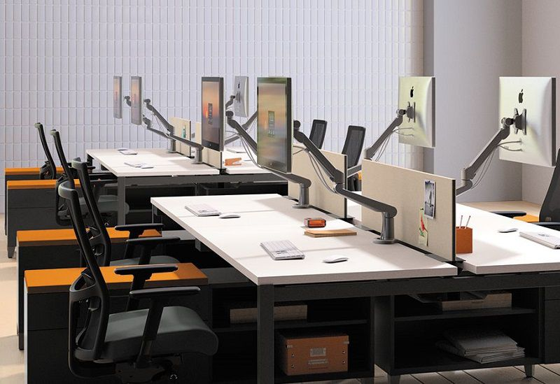 Room scene with open office plan - Ignition task chair, Empower desks, Contain footed credenza