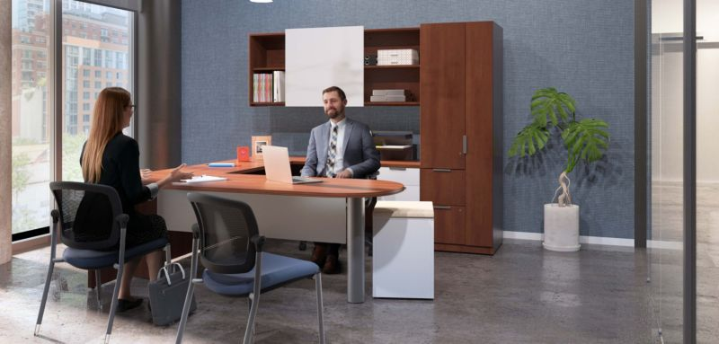 Two people in private office with furniture - Ceres Task and Multipurpose Stacking Chair, Concinnity Desk and Pedestal With Cushion