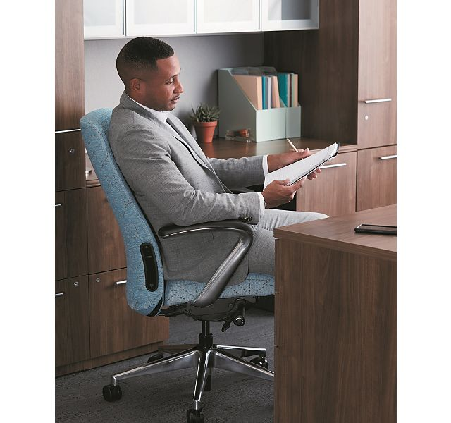 Man sitting in an office chair at a desk