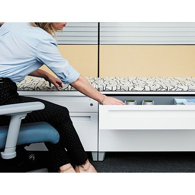 Individual reaching for a lateral file cabinet