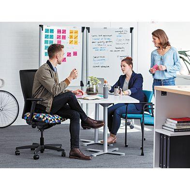 Team gathered around a desk collaborating
