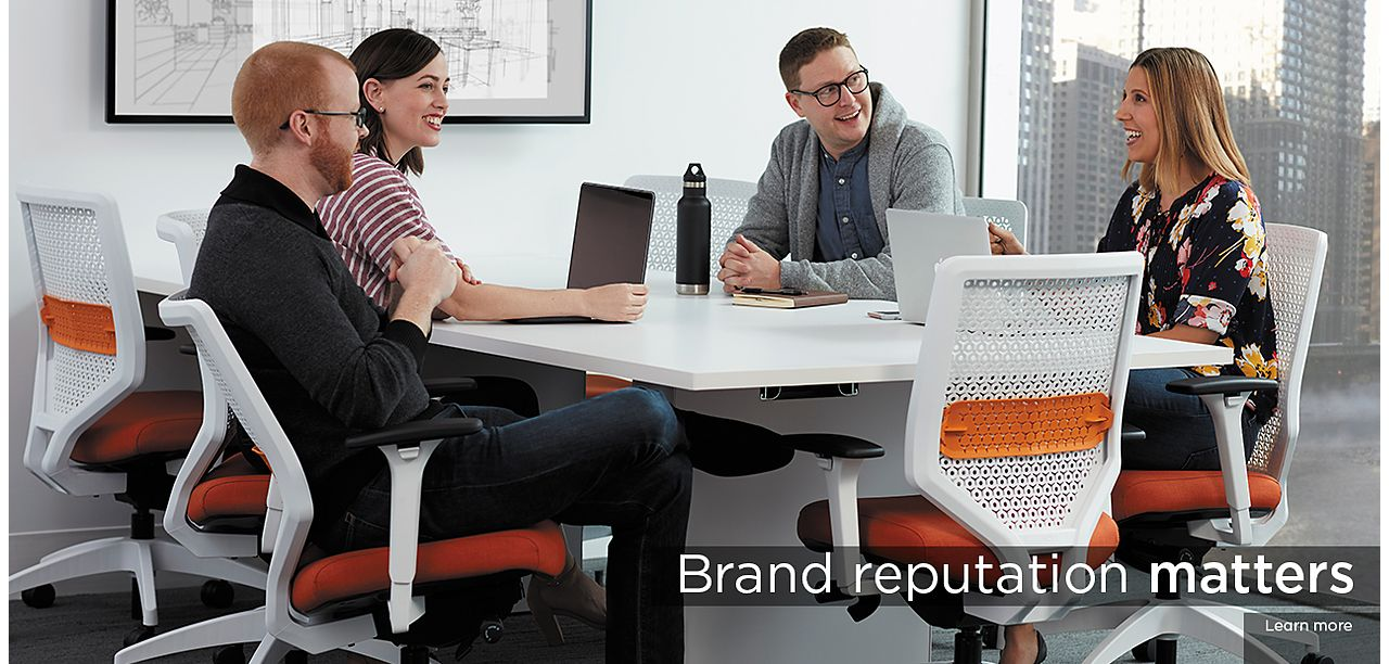 Team Around Conference Table With Solve Office Chairs