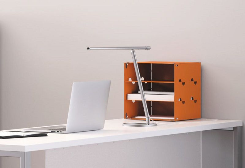 Voi worksurface with modesty panel and O-leg supports, task desk lamp